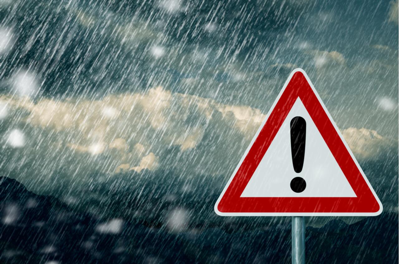 caution sign in bad rainstorm